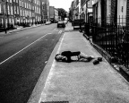 B&W-man-lying-on-street